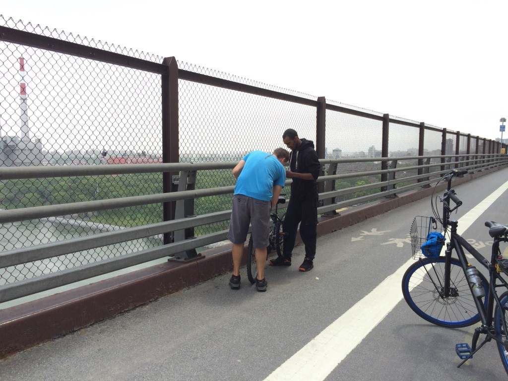Queensboro Bridge fix.. tightening down the stem and handlebars. When someone looks like they have an issue, Ron asks if they need help and you should see the smiles.