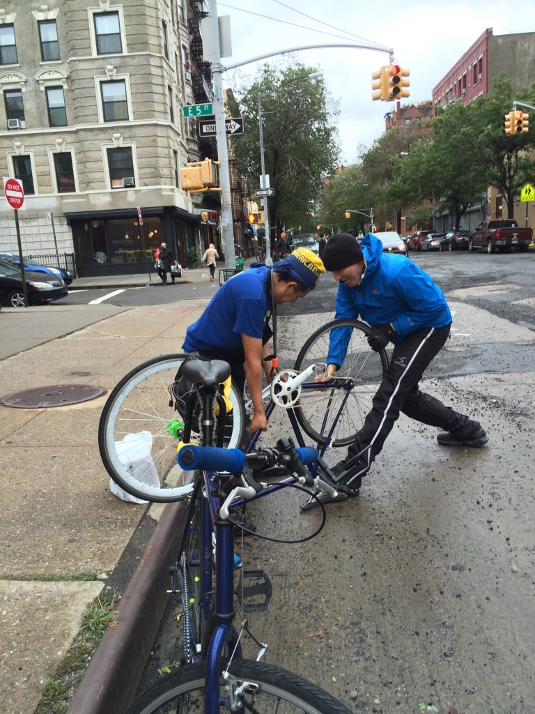 This delivery guy down in NYC's Alphabet City had crashed. Despite the blood pouring out of him, Ron fixed his wheel and retensioned his chain. (I helped too.. I gave him a band-aid : )