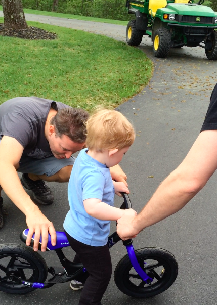 This cutie pie needed a seat adjustment. Yep, starting him early... no pedals, no training wheels.