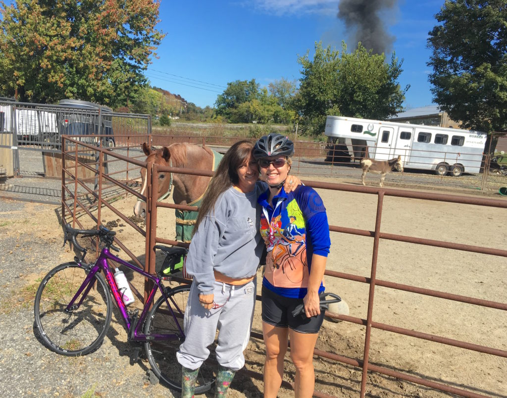 My girl Lorine gave me a good squeeze (with the fire raging in the distance). After this quick photo she went to relocate the neighbor's horses who were near the fire.