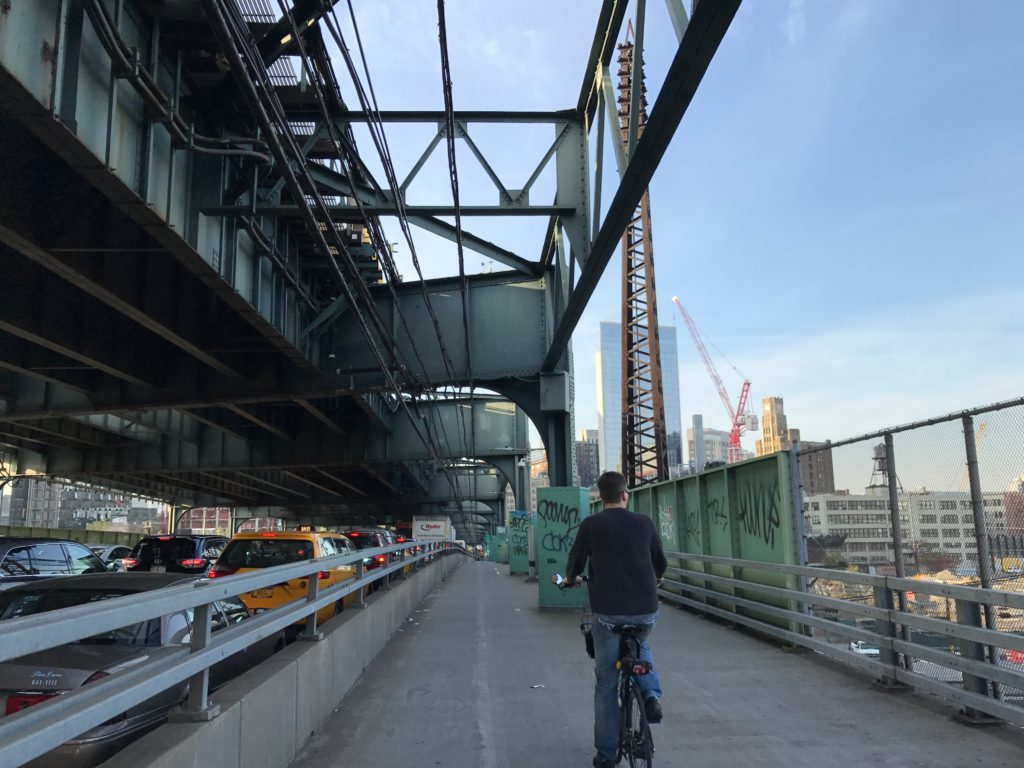 Approaching the Queensboro Bridge, I am reminded how happy I am to be on a bike, and not in a car.