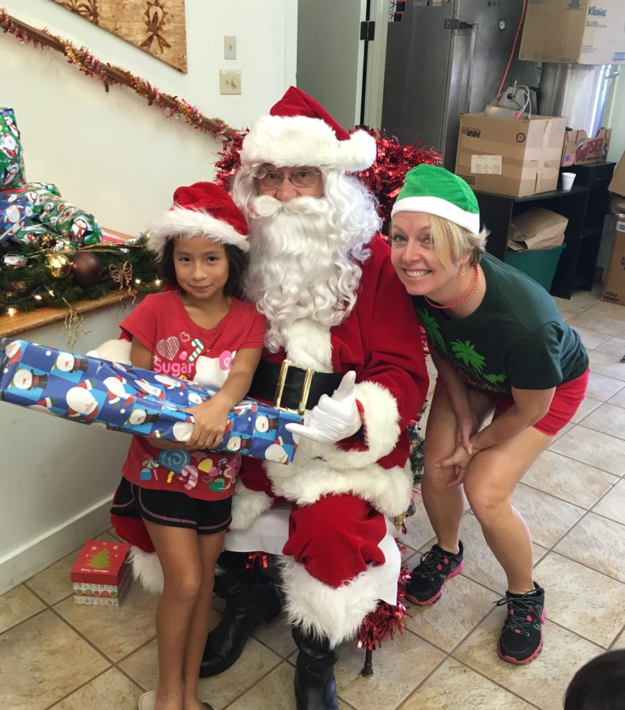 Santa made a visit and the keiki (children) got gifts. They all got a pair of shoes, plus fun gifts that were donated. We saw some real excitement and joyous smiles.